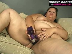 Nasty dark head bitch with huge boobs and fat ass is wearing lacy black lingerie. She takes off the underwear teasingly. When she totally naked she pokes her twat with smooth dildo.