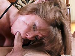 Fuckable long haired brunette mature hottie clings to hard penis of young beefy dude to give it deepthroat blowjob before she tops it to ride cowgirl style.