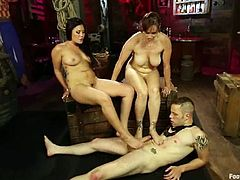 Bella Rossi, London Keyes and are having some good time with Wolf Hudson in the study. The girls make the dude lick their feet and then please him with a footjob and get fucked.