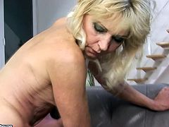 This sex-starved granny wants to get really with this stud's cock! She takes his dick up her loose snatch and rides it in cowgirl position. Then she gets into sideways position to let him fuck her hairy twat hard and deep.