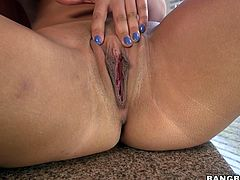 Intoxicating beauty Eva Lovia spreads her legs wide apart showing off mouth-watering pink pussy. She slides her fingers in slick pussy hole masturbating passionately.