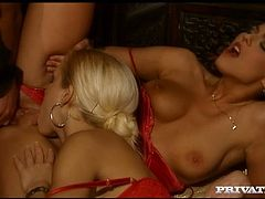 These two sexy lesbians look so cock hungry as they give blowjob to muscular guy with big cock. They definately got fucked hard in their assholes by their macho man.