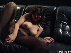 This hot Asian is wearing a full body fishnet catsuit. She has a hairy pussy where she likes to insert her white vibrator.