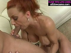 Trashy hooker with big silicon boobs gets her pussy licked by thirsty bald dude. After spicy oral pleasures busty bitch is fucked hard doggy style.