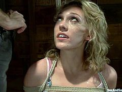 Salacious blonde Lily Labeau is having fun with James Deen in a basement. She lets the man tie her up and then James fucks Lily's pussy with a dildo and pokes his hand into her coochie.