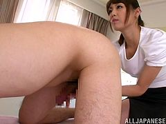 This juicy and sizzling Japanese hottie is going to perform an amazing handjob! She makes him even bend over and that's kinda weird and so hot!