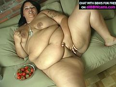Lusty bitch gets messy with cream greased all over her boobs and pussy. She dips strawberry in cream that is smeared over her tits and swallows it.