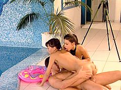 It's a poolside FFM threesome with Dorothy Black and Kathy Divan, two sexy and horny brunettes who even venture in a DP with cock and strapon!