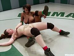 Interracial lesbian wrestling match! Chicks get on teh pitch to win and win only! They got power and they got skills to do that! Check who wins.