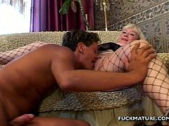Blonde mature slut gets her cunt destroyed by that nasty and wild fucker, he is using huge black dildo to make her hole bigger for his cock.