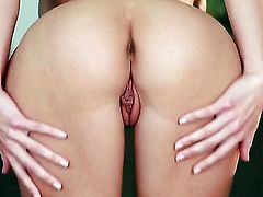 Randy Moore with juicy jugs and smooth snatch fingering her slit