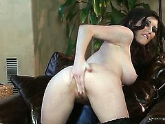Just Amber with juicy hooters and hairless cunt fucks herself to orgasm in solo action