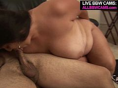 Attractive brunette MILF with ample curvy body is extra size porn model. She takes off her clothes exposing her body shape in all the glory. After hot strip tease she gets down on her knees sucking hard juicy cock deepthroat. She appears to be damn good in blowjob.