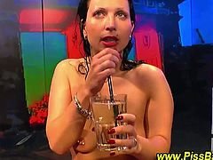 Check out this horny german slut getting her snatch destroyed by multiple cocks. She also loves to drink fresh urine and receives a nice cocktail in the end!