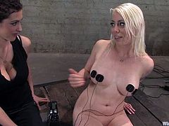 Slutty blonde Lorelei Lee is getting naughty with some dark-haired girl indoors. She lets the dominatrix attach wires to her big natural tits and ass and enjoys it a lot.
