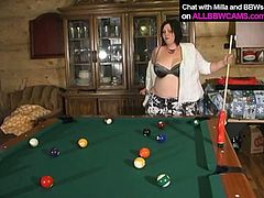 Trashy BBW takes off a piece of cloth if she misses the billiard pocket while playing at solo video. After she loses the game she starts masturbating with big sex toy.