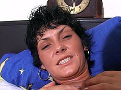 Kinky dark-haired mom Ramona lies on a bed with her legs moved wide apart and lets some blonde girl massage her juicy pussy.