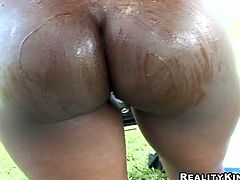 Diamond Jackson is a stunning ebony babe with big round tits and an ass that'll just leave you speechless. Check her out as she takes off her clothes before she's fucked by a big cock outdoors.