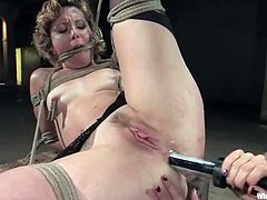 Lorelei Lee is having a good time with kinky bitch Tina Horn in a basement. Lorelei binds Tina and attaches leads to her nipples and then pokes a dildo into her tight asshole.