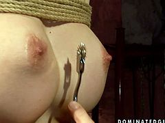 Pale skinned blonde bitch is getting her nipples pumped in BDSM porn video