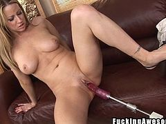 Watch this blonde, she likes rubbing a dildo with her boobs, pretending it's a real cock. All that made her pussy wet so now she's up for some serious pussy drilling. The whore makes herself comfortable on the couch, spreads her legs and receives the sex toy deep in her snatch. Maybe she needs some in her ass!