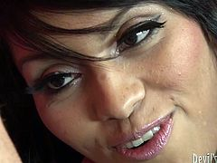 Brunette ladyboy likest it hotter and enjoys hand job by one kinky dude. He jerks off her small dick and licks her flat chests and tiny nipples.