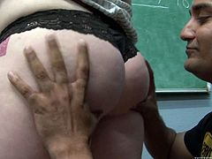 Ample blond teacher gives a head to her student after welcoming tongue fuck from him