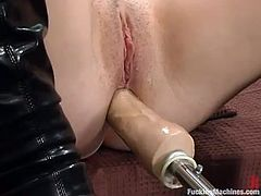 Brunette cutie Valerie Herrera is having fun in the living room. She gets her nice tits pumped and then gets her sweet pussy and tight ass smashed by a fucking machine.