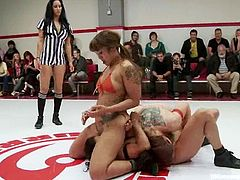 A few hot lesbians are going to have a fight on tatami. They take their bikinis off and demonstrate their bodies and then have a wrestling match and get their pussies pounded with strapons.