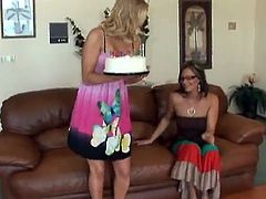 Sexy blonde mom Tara seduces her GFs and talks them into making lesbian love. They stroke each other's amazing bodies and then show their nice pussy-licking skills.