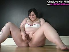 Fat ass bitch is sitting by the wall being totally naked. She spreads her legs apart drilling her pussy with smooth sex toy. Passionate BBW solo masturbation clip presented by All BBW Cams studio.