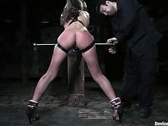 Sexy girl with nice ass gets gagged with a muzzle gag and tied up to the post. Later on the guy toys her pussy with a vibrator.