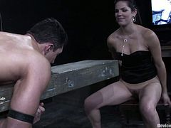 Gorgeous brunette Bobbi Starr is having fun with Romario Faria in a basement. She lets the man tie her up and then enjoys his massive schlong in her tight pussy.