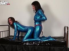 Look at this fucked up whore, her expression as she stays there bent over wearing her latex costume and getting drilled from behind. Her girlfriend knows how to use that big black strap on dildo and makes the bitch moan with pleasure. She goes as deep as she can and massages herself while fucking the slut.