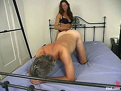 Kym Wilde is having fun with an elderly guy called Willie. She binds the dude and whips him with a lash and then rubs her snatch against his cock and treats him like a bitch.