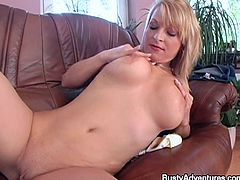 Sarah is on her couch and plays with her breast all alone. Let's keep this busty whore some company as she pleasures herself by groping and squeezing those big, sot boobs. After she's done plating with her breasts, the fucking whore grabs a dildo and stuffs her pussy with. She enjoys herself and wants more!