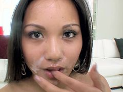 Needy babe sucks it in POV and enjoys huge load filling her asian mouth
