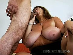 A huge-breasted brunette fattie is having fun with some dude indoors. She favours him with a passionate blowjob and then they fuck in the reverse-cowgirl and other positions.