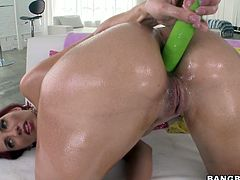 Provocative mature mom Kelly Divine is standing of her all four lifting her ass up in the air. Her butt is oiled up. Kelly stuffs her anus with fat sex toy. Later on she gets ass fucked hard from behind.