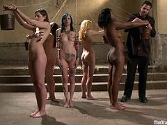 Coffee Brown, Iona Grace and other chicks are playing dirty games with some men in a cellar. The guys bind the chicks, humiliate them and play with their pussies and tits.