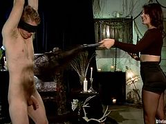 Kinky brunette mistress whips Danny painfully. Later on she rides big dildo fixed to his mouth. In addition she destroys his ass with a strap-on.