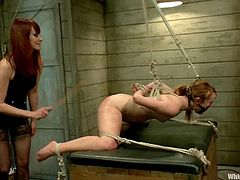 Blonde chick gets tied up and whipped painfully by stunning redhead mistress. Then she licks Claire's vagina with pleasure.
