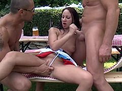 Brunette girl in fancy dress gets fucked by two men