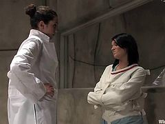 The brunette in straitjacket is a crazy vixen who is going to be toyed, spanked and dominated by the mental institute's doctor.
