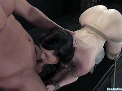 Amazingly hot Daphne Rosen gets tied up. Then she gets her huge boobs massaged and pussy fucked hard. In addition a guy licks her vagina and pours hot wax on her belly.