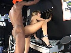 Slutty white ass bitch seduced black dude at the music studio. She stands along the wall getting rammed deep from behind.