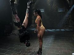 Nasty dark-haired chick Mika Tan is teaching some dude a lesson in a basement. She whips and tortures the dude and then fucks his ass with a strapon from behind.