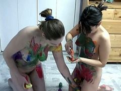Chubby amateur girls having small tits are sitting naked on a floor. They start rubbing one another with paint. Filthy hookers get messy and start lesbian fuck in front of cam.
