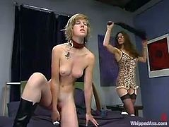 Chloe Catastrophe is playing dirty games with lecherous dominatrix Kym Wilde. She lets Kym beat her and then enjoys having a strapon in her cunt.