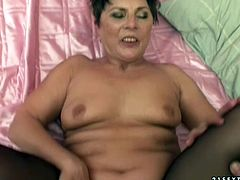 Dirty hoe is wearing black nylon stockings fucking in hardcore porn clip. She is pounded deep in her clam missionary style. She also gets finger fucked later on.